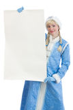 Girl dressed in russian christmas costume. Smiling girl dressing in traditional russian christmas costume of Snegurochka (Snow Maiden) with blank banner Stock Photo