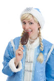 Girl dressed in russian christmas costume. Smiling girl dressed in traditional russian christmas costume of Snegurochka (Snow Maiden) eating ice cream, isolated Stock Photography