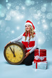Girl dressed in santa hat with a Christmas Royalty Free Stock Photography