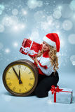 Girl dressed in santa hat holding with a Christmas Stock Photos
