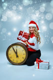 Girl dressed in santa hat holding with a Christmas Royalty Free Stock Image