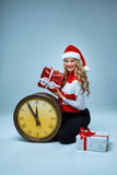Girl dressed in santa hat holding with a Christmas Royalty Free Stock Photography