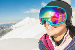 Girl dressed in ski or snowboard fashion mask goggles Stock Photography