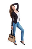 Girl dressed in stylish blue jeans Royalty Free Stock Image