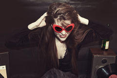 Girl dressed in sunglasses Stock Photo