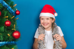 The girl dressed tinsel on a neck and laughs Stock Image