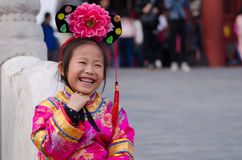 Girl dressed in traditional Chinese costume Stock Photos