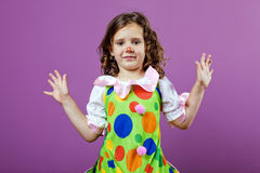 Girl dressed up as a clown Stock Photo