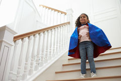 Girl Dressed Up As Superhero Playing Game On Stairs Stock Image