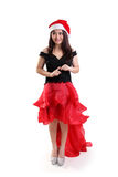 A girl dressed up for Christmas, standing and looking away Royalty Free Stock Images