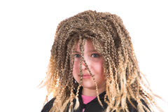 Girl dressed up with a funny rasta wig Stock Photography