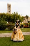 Snow White at Lucca Comics and Games 2017. A girl dressed up in SnowWhite poses in a garden during the Lucca Comics and Games 2017 festival Royalty Free Stock Photos