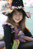 Girl dressed-up on witch dress. Girl dressed-up on colorful witch dress Stock Image