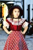 Girl dressed in vintage dress with hat Royalty Free Stock Images