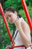 Girl dressed in white ride the swing Royalty Free Stock Photo