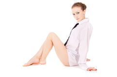 The girl dressed in a white shirt, and tie posing Stock Photos