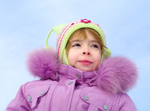 Girl dressed in winter clothes Stock Images