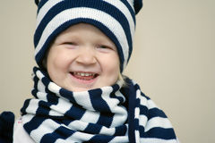 Girl dressed with winter hat and scarf Royalty Free Stock Images