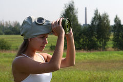 Girl dresses a gas mask. On danger nature Royalty Free Stock Photos