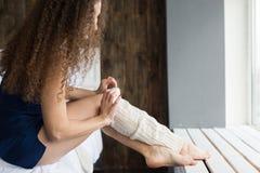 Girl dresses knee socks. Royalty Free Stock Photos