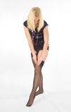 Girl dresses stockings Royalty Free Stock Photography