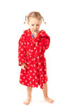 Girl in dressing-gown with toothbrush in hand Royalty Free Stock Photography