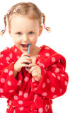 Girl in dressing-gown with toothbrush in hand Royalty Free Stock Images