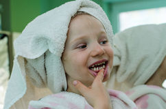 Girl in dressing-gown with towel over head Royalty Free Stock Image