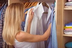 Girl in a dressing room. Back view of beautiful girl choosing clothes in her dressing room Royalty Free Stock Photos
