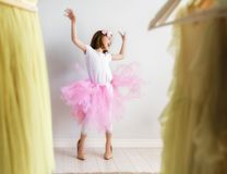 Girl dressing up at home Stock Photo