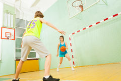 Girl dribbling the ball during basketball match Royalty Free Stock Photos