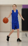 Girl dribbling basketball Stock Image
