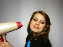 Girl dries hair the hair dryer. Nice girl dries hair the hair dryer royalty free stock photos