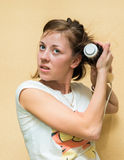 Girl dries hair the hair dryer. Brunette young girl dries hair dryer electric Stock Images