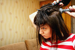 Girl dries hair stock photos