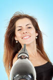 Girl dries long hair with hairdryer stock photo