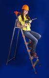 Girl with drill. Girl in a hard hat with drill on stepladder Stock Photo