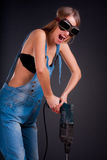 Girl with a drill Stock Image