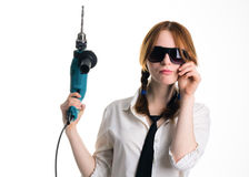 Girl with a drill Royalty Free Stock Photography