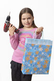Girl with a drill. Cute girl who got a drill as a Christmas present stock photography