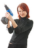 Girl with a drill in the hands. A young beautiful girl with a drill in the hands Stock Photo