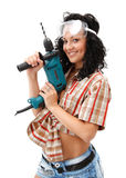 Girl with drilling machine Royalty Free Stock Photo