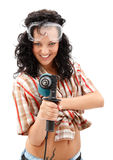 Girl with drilling machine. A young smiling female worker with a drilling machine in her hand Royalty Free Stock Images