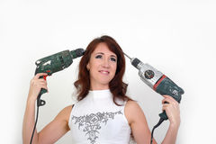 Girl with drilling machine. Young do-it-yourselfer with a drilling machine Stock Photo