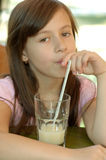 Girl and a drink Royalty Free Stock Image