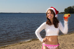 Girl with drink on the beach.  Christmas vacation Royalty Free Stock Photos