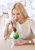 Girl drink bright tropical cocktail Stock Photo