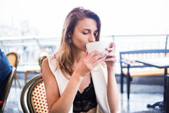 Girl drink in cafe Stock Image