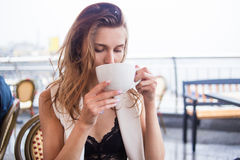 Girl drink in cafe Royalty Free Stock Images