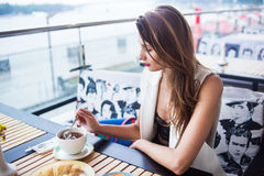 Girl drink in cafe Royalty Free Stock Photography